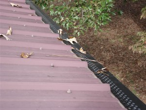 Which are the proper climates for a vinyl rain gutter?