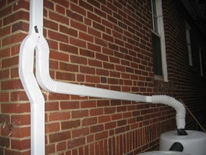 Instructions for installing downspouts on concrete walls