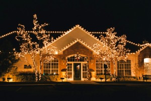 Besides Christmas decorations what other use do outside lights have?