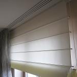Costura de persianas o cortinas de una claraboya