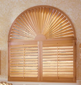Unusual shaped windows and roll-up blinds